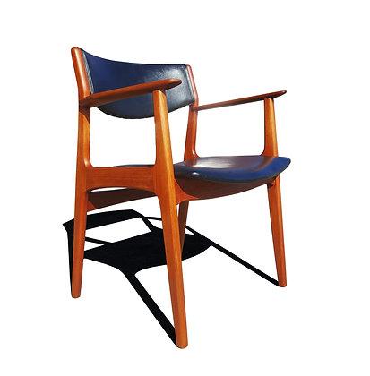 A Danish mid-century - MCM - teak office armchair by Henning Kjærnulf