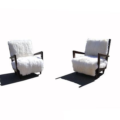 A pair of Italian mid-century modern sheepskin armchairs