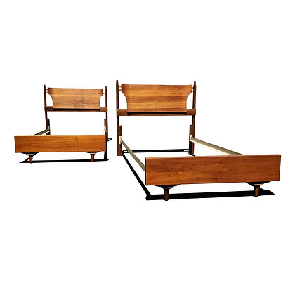 A pair of mid century modern twin beds - headboards.