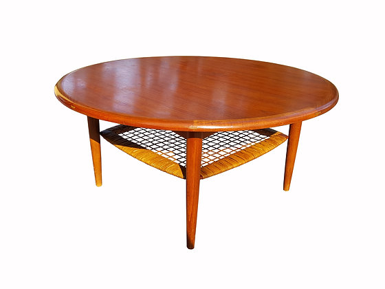Danish mid century Modern teak coffee table with cane shelf by Johannes Andersen