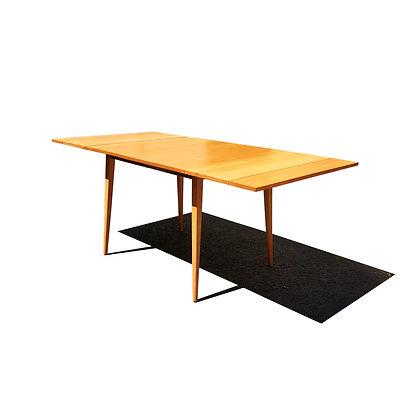 A mid-century modern Paul McCobb planner group dining table