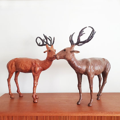 A pair of large leather deers / harts sculptures