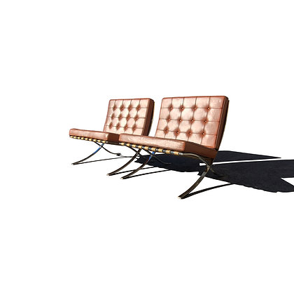 A pair of Knoll leather Barcelona lounge chairs