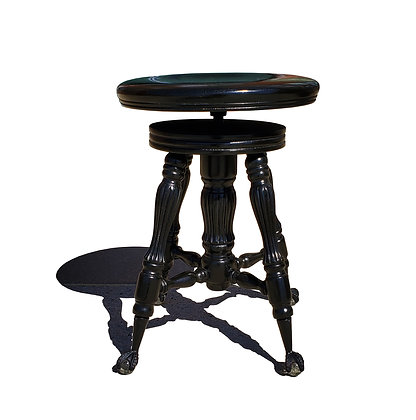 An antique piano stool