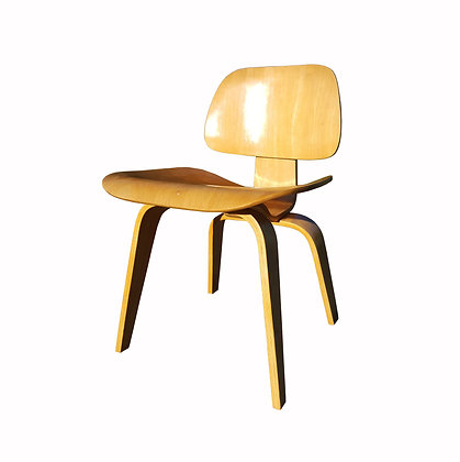 Vintage mid-century modern plywood LCW Eames chair.