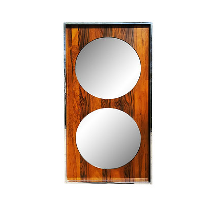 A mid-century modern space-age chrome and rosewood pop mirror