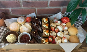 Pre-order your High Tea for the Races & enjoy your Spring Carnival at home.  Designed to feed up to 6 people, these boxes offer our Chef's Selection of quality produce, made in-house by our team of Chefs, including options for Gluten Free, for you and your family to enjoy.  -Scones -Jam and Cream -Signature Carrot Cake Squares (contains walnuts) -Petite Torched Lemon Meringue Tarts -Mini Muffins (GF) -'Ferrero' Chocolate Triangles (GF.  contains hazelnuts) -Champagne Poached Chicken and Chive Sliders  Garnished with strawberries and dusting sugar
