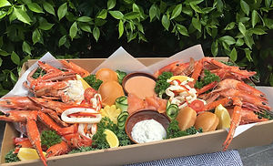 Pre-order your Seafood box - perfect for any occasion or to 'bring-a-plate' outings!  Designed to cater for up to 6 people, these boxes offer our Chef's Selection of quality produce, carefully selected and prepared by our team of Chefs.  PN:  3 business days' notice required prior to the day you would like to collect your box.  Pick up times available between 10am - 2pm.  -Cooked QLD King Prawns -Cooked Blue Swimmer Crab -Marinated Squid in a red capsicum, carrot, parsley, salt and pepper oil -Slider Buns -Cocktail Sauce -Caper & Cream Cheese w/ lemon, parsley and chives -Cucumber curls -Lemon  Garnished with kale, curly parsley and cos leaves