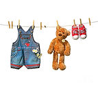 childrens-clothes-with-teddy-bear-on-clo