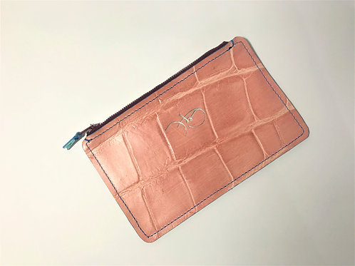 The Versatile Pocket Pouch in pink croc.