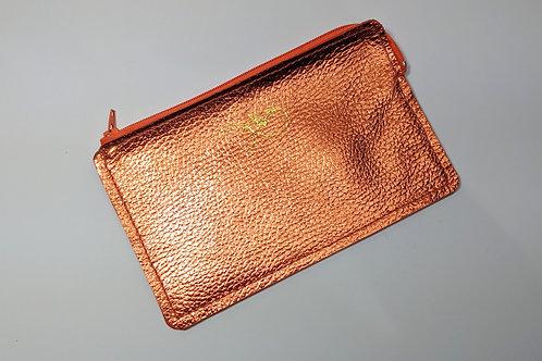 The Versatile Pocket Pouch in metallic orange.