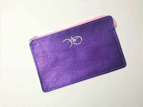 The Versatile Pocket Pouch in metallic purple..