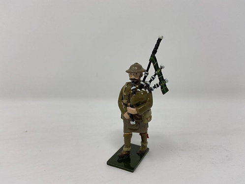 Fig 69 - WWI Piper, tin helmet at march