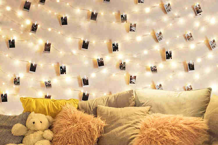 polaroid pictures in fairy light string