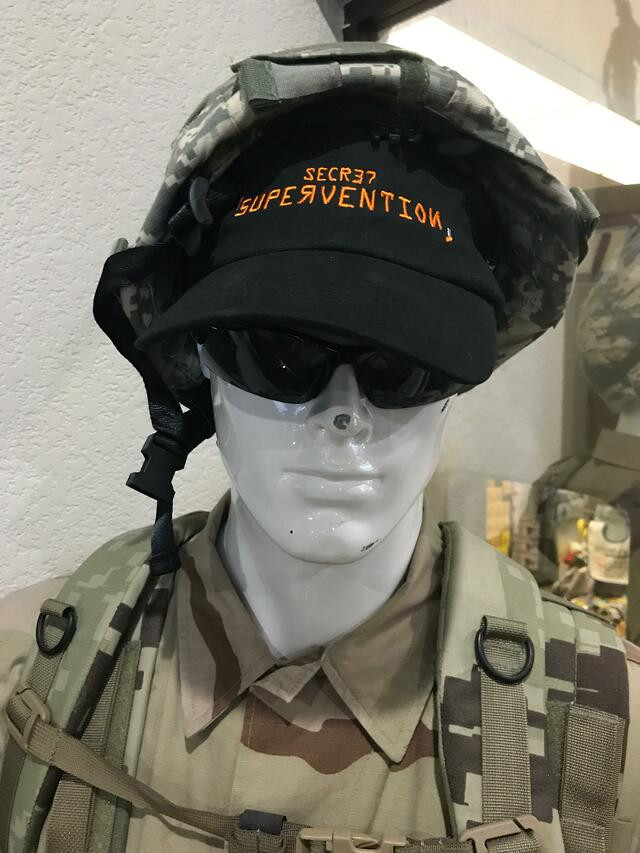Mannequin wearing military uniform.
