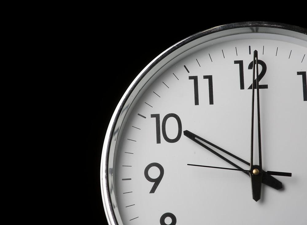 Silver clock showing 10 o'clock.