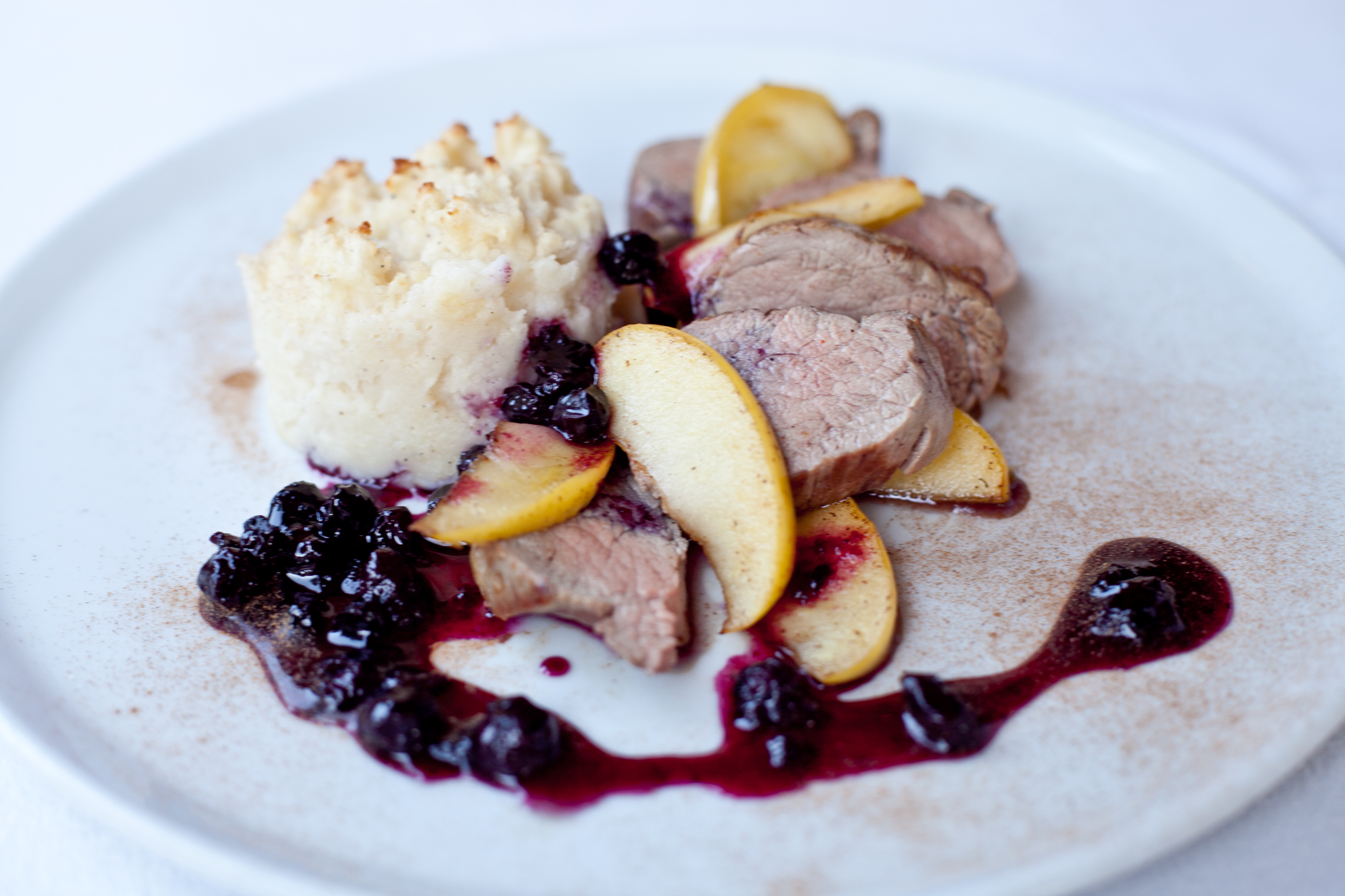 Pork fillet with mashed potato, caramelized apple and cranberry