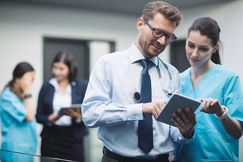 doctor-nurse-discussing-digital-tablet.j