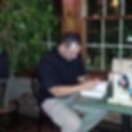 A picture of Jason E. Fort signing books at his first book signing.