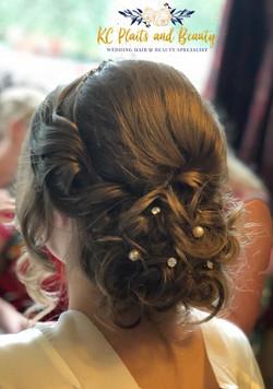 wedding hair messy bun with twists