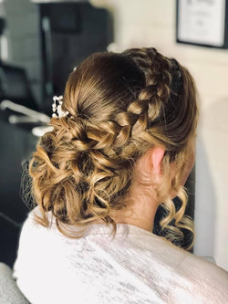 Beautiful brides textures updo with plai