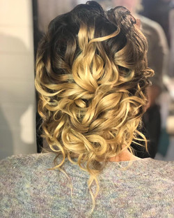 Beautiful messy updo for this Bride
