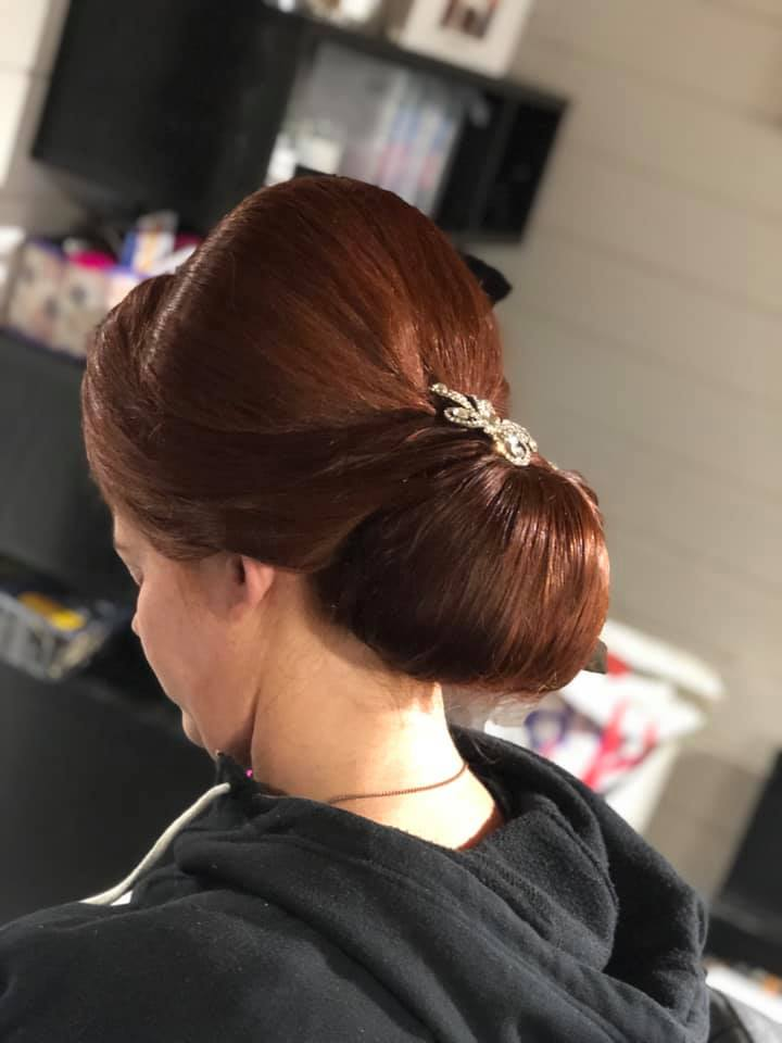 large smooth bridal bun with height
