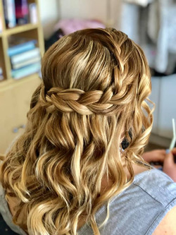 Beautiful wedding hair style with plait.