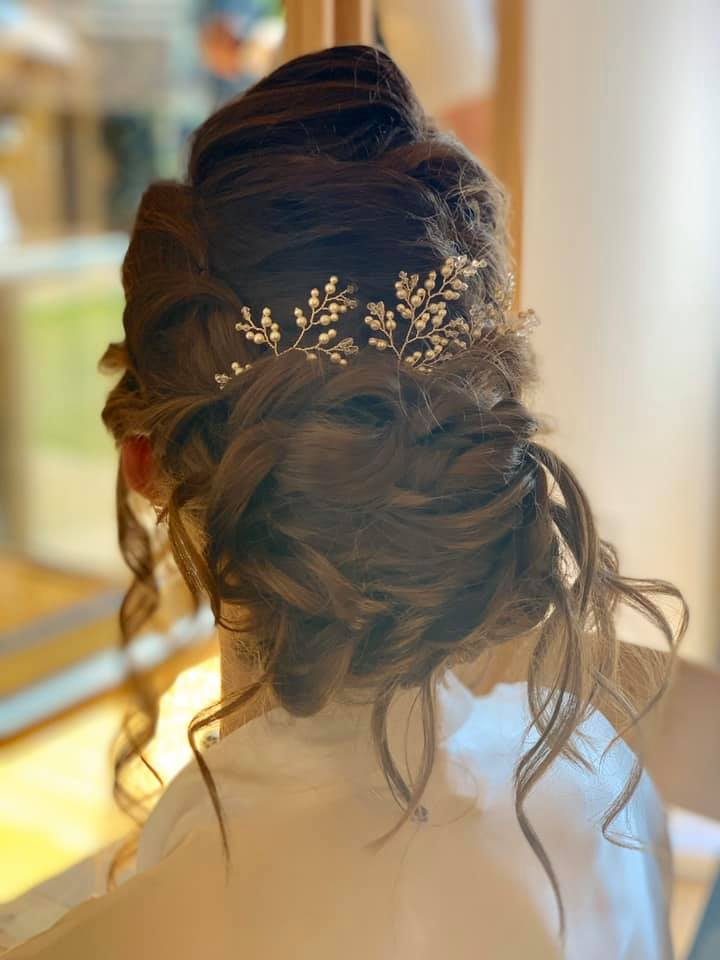 Beautiful messy updo for this beautiful