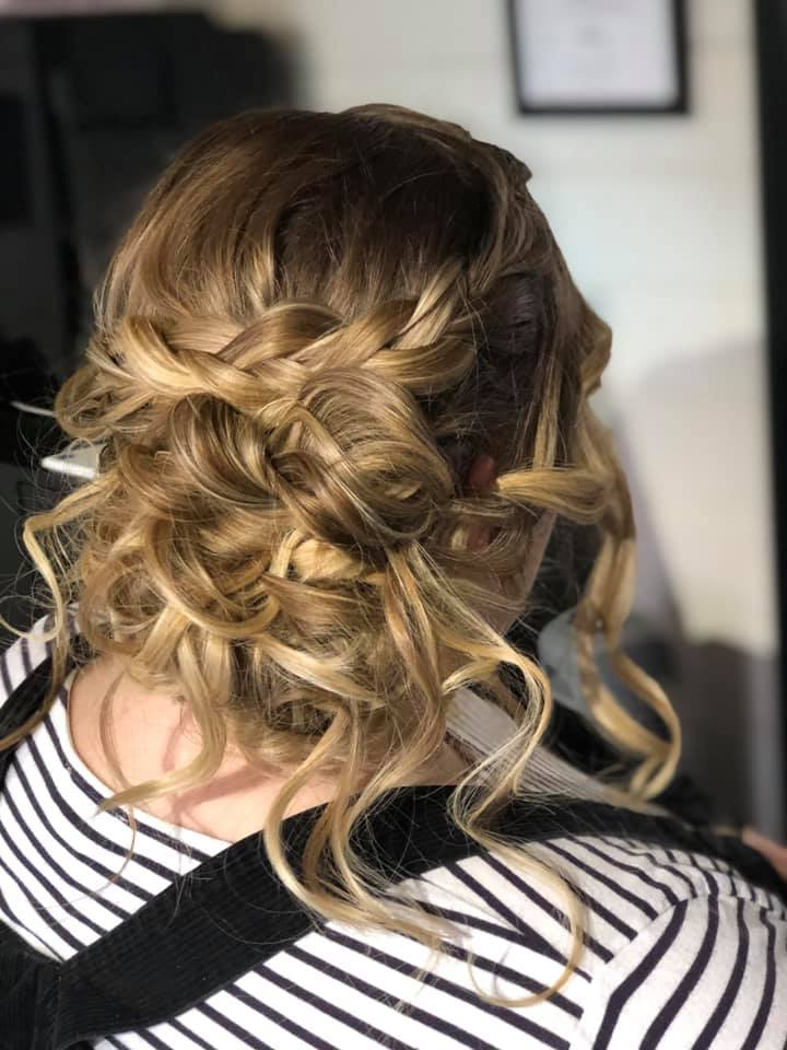 Gorgeous messy bridal hair bun with plai
