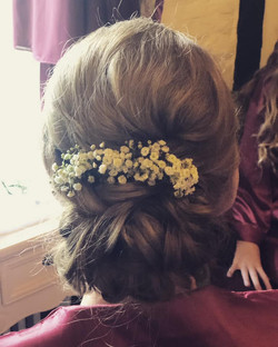 bridesmaid hair updo with flowers