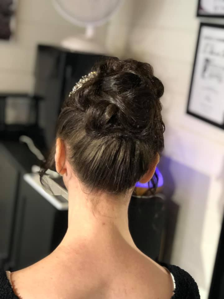 Neat and textured wedding hair updo