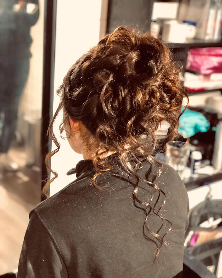 Beautiful messy bun hair style in essex.
