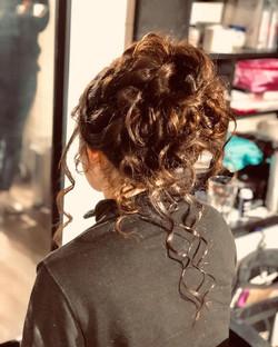 Beautiful messy bun hair style in essex.