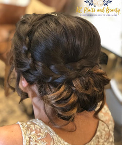 Indian wedding updo with plaits