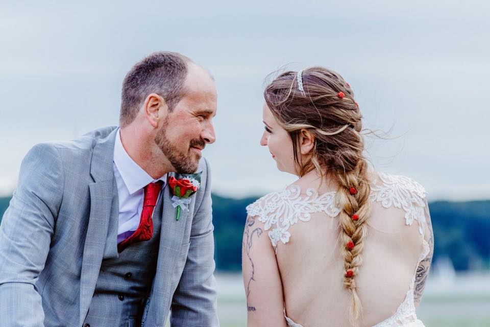 wedding hair plait with roses