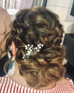 Beautiful textured an curly updo for thi