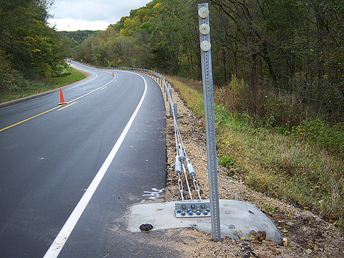 Cable guardrail end anchor