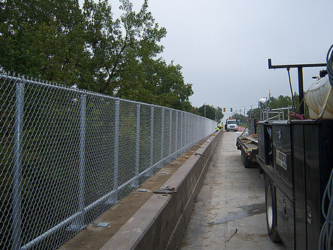 Fence guard on side of bridge
