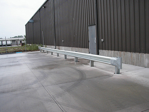 Curled end guardrails at industrial site