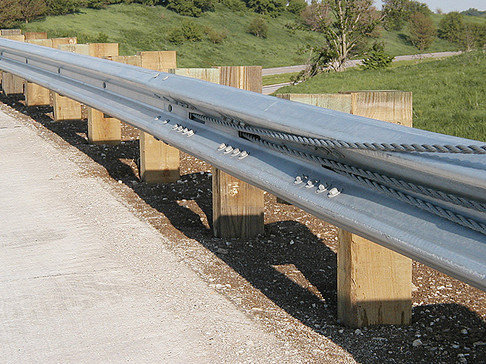 Cable attachment to traditional guardrails