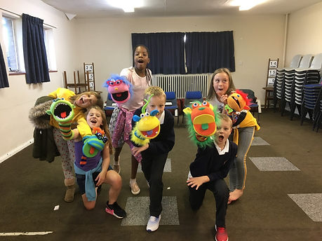 Children holding puppets at Buttercross Theatre Productions