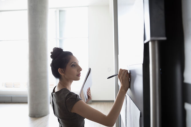 Woman drawing on a whiteboard