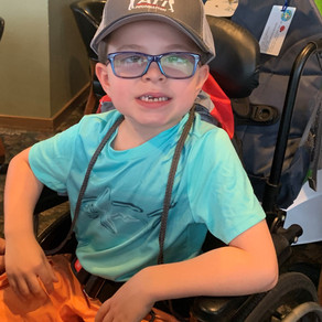 Two Massachusetts Children Presented with Adaptive Bicycles at Golf Outing
