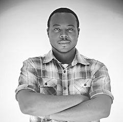 """Artiste, compositeur et ingénieur du son, il est considéré comme l'un des meilleurs techniciens sonore de sa génération dans le secteur musical en Afrique. Son expérience se mesure aux nombreuses collaborations et productions exécutives réalisées pour des artistes confirmés de la scène musicale africaine. Il est la """"fine oreille"""" de l'équipe capable de sublimer les créations du label et d'assurer la production de masters de grandes qualités."""