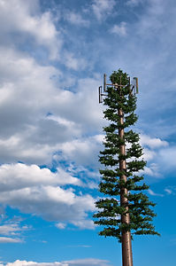 Creative cell phone tower made to look l