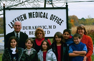 Dr. Durakovic and Project Life Director, Linda Redfield Shakoor, with local volunteer, Terri Bedford, and orphans from Ingushetia, 2002