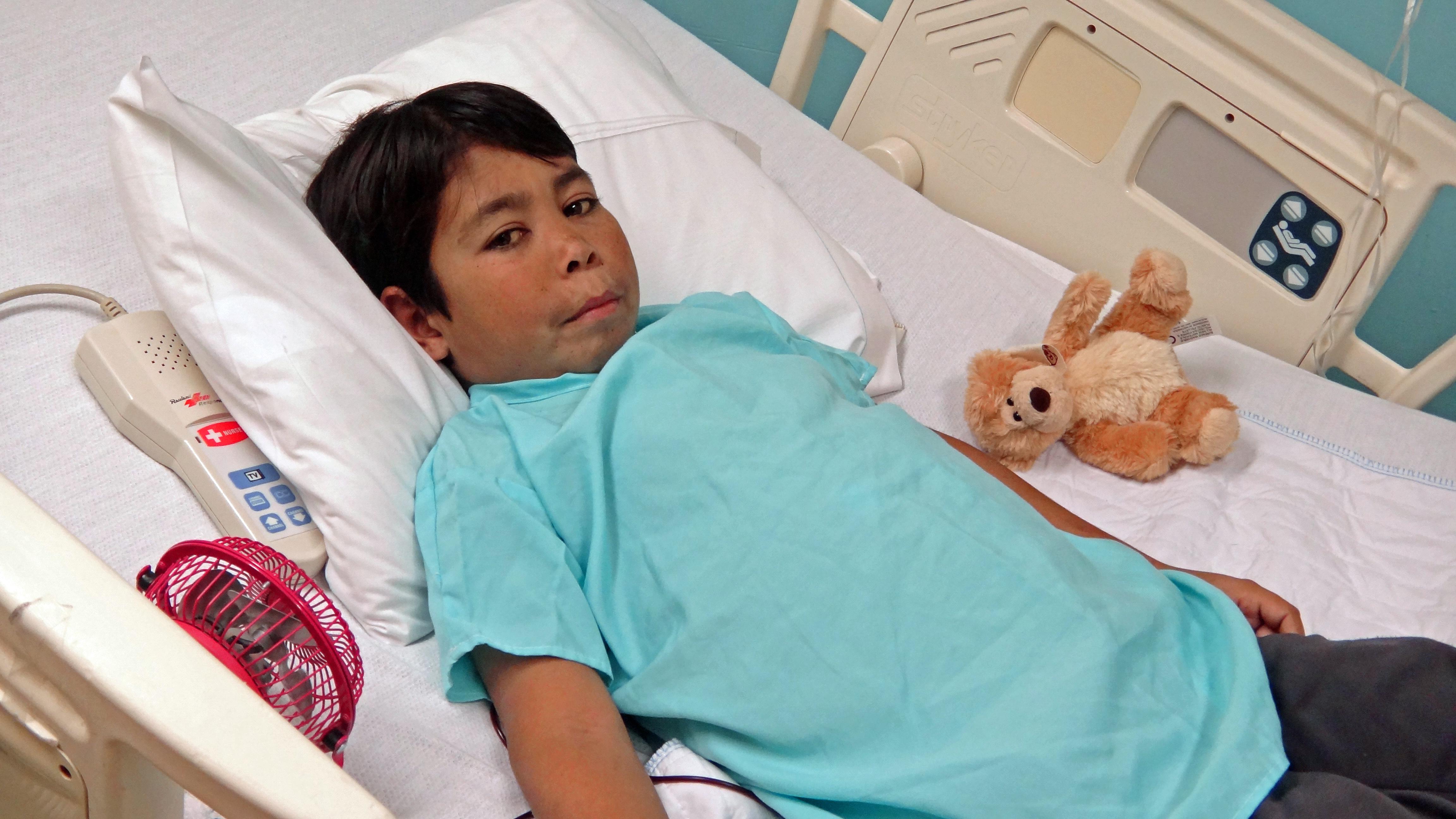 PL Mohammad in Hospital Bed.jpg