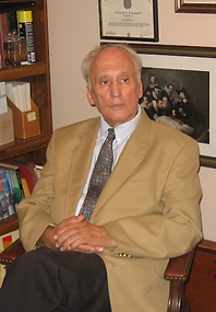 Founder Dr. D with books.png