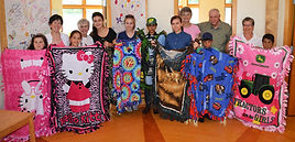 Project Life students are pictured with their blankets after working on them with volunteers from the Carlton United Methodist Church.